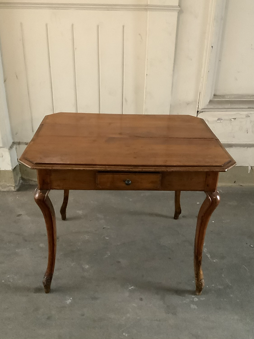 A wooden table with four drawers .