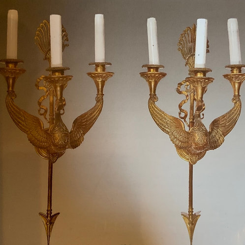 A pair of gilded bronze wall lights in the shape of a swan.
