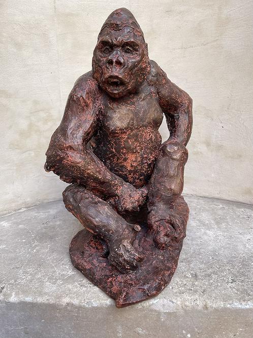 A terra-cotta sculpture of a gorilla . Artist : Robert Godefroy 1928 -2001 .