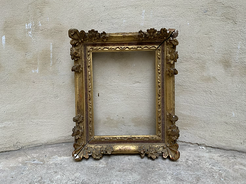 A wooden sculpted frame from the XVIII century.