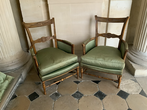 A pair of early XIX century French arm chairs with revolutionary carvings.