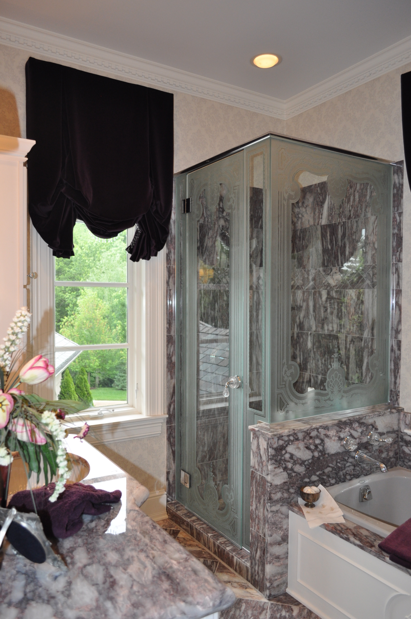 Custom design carved shower glass.