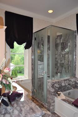Custom design carved shower glass.