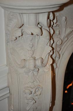 Intricately carved fireplace mantel