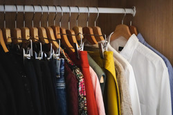 lot-different-clothes-hanging-wardrobe (