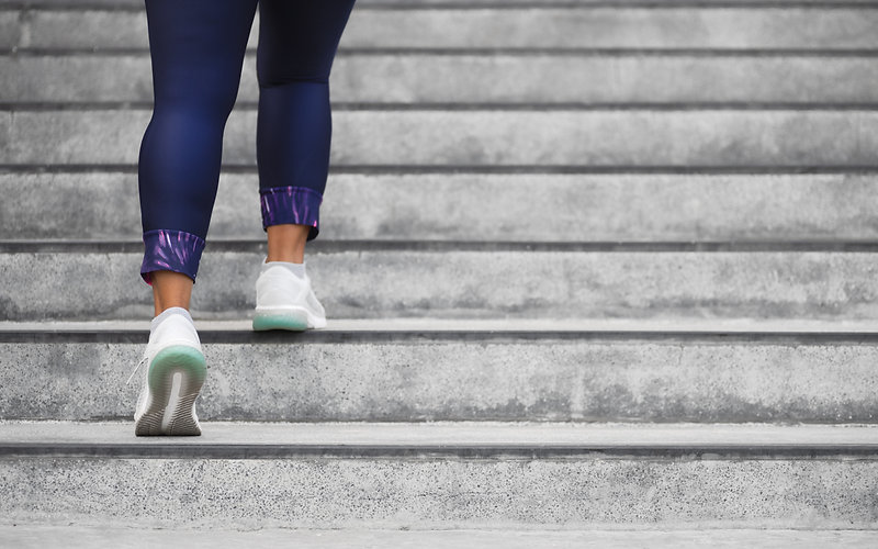 female-runner-athlete-doing-stairs-climb