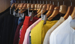 lot-different-clothes-hanging-wardrobe
