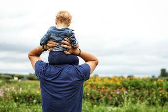 baby-sitting-on-man-s-shoulder-1497394.j