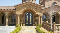 1-Transitional-Mediterranean-Entryway-with-Columns-and-Balustrade-System-in-Tobacco-Cantera-Stone