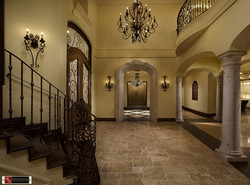 2-Grand-Foyer-with-Stone-Entry-Surround-to-Dining-Room-and-Tapered-Stone-Columns