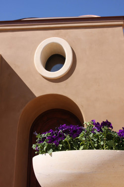 1-Refined-Territorial-Southwest-Tradtional-One-Piece-Oval-Window-Surround-in-Stained-Limestone-with-