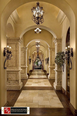 1-Old-World-Raised-Panel-Columns-at-Hallway-Entry-in-Oro-Cantera-Stone
