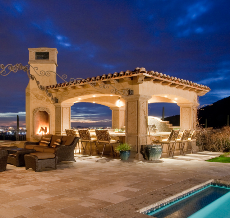 carved stone poolside bar and fireplace