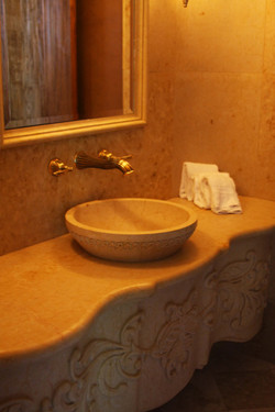 11-European-Vanity-and-Vessel-Sink-with-Ornate-Front-Skirt-in-Marble