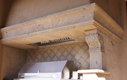 17-Traditional-Barbecue-Range-Hood-Surround-with-Corbels-in-Tobacco-Cantera-Stone-with-Distressed-Fi