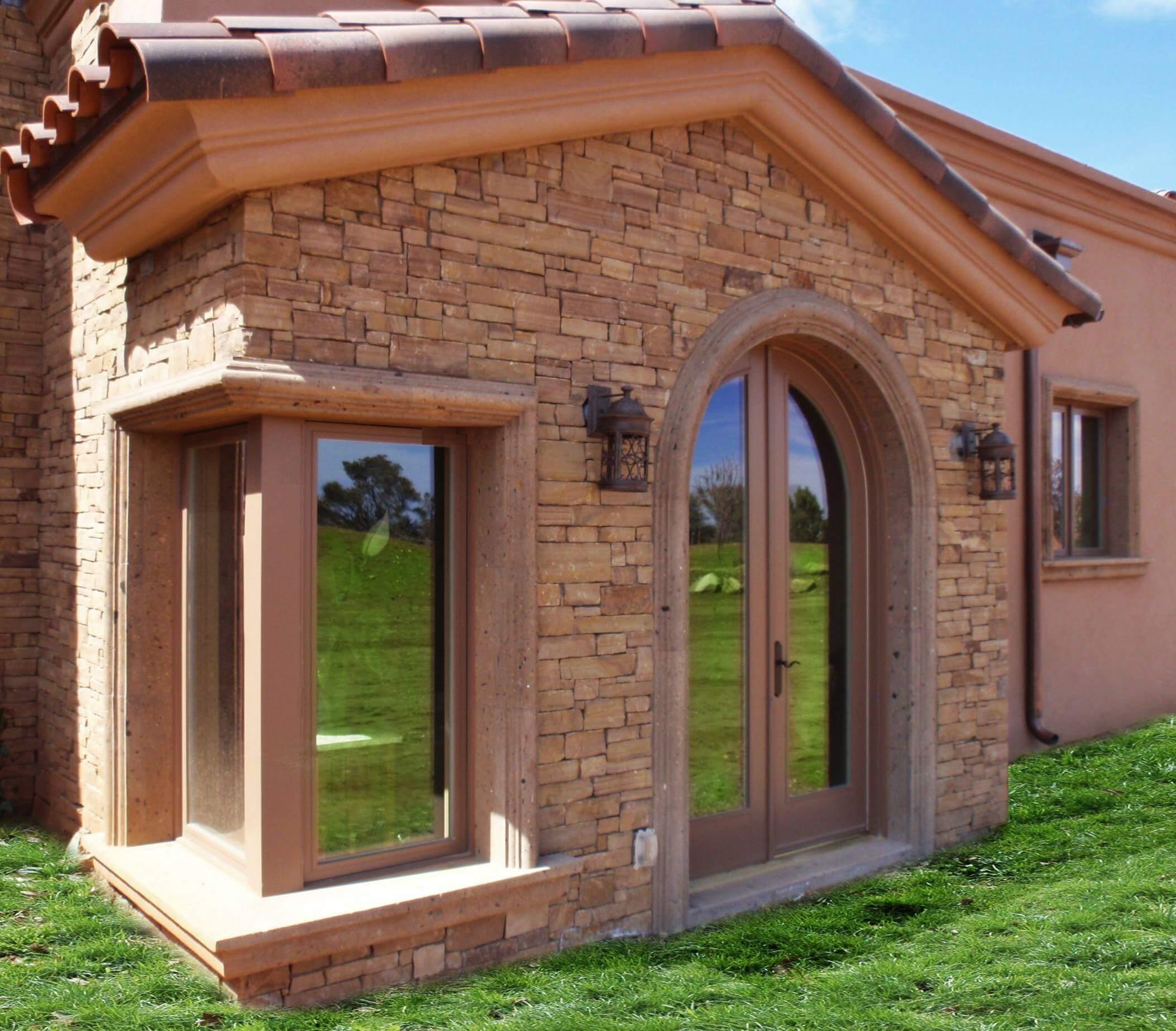 8-Transitional-Mediterranean-Arched-Door-Surround-in-Tobacco-Cantera-Stone
