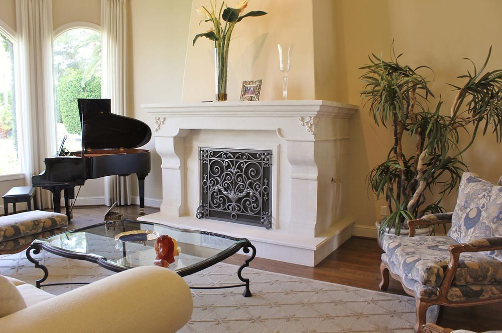 elegant limestone fireplace surround and mantel