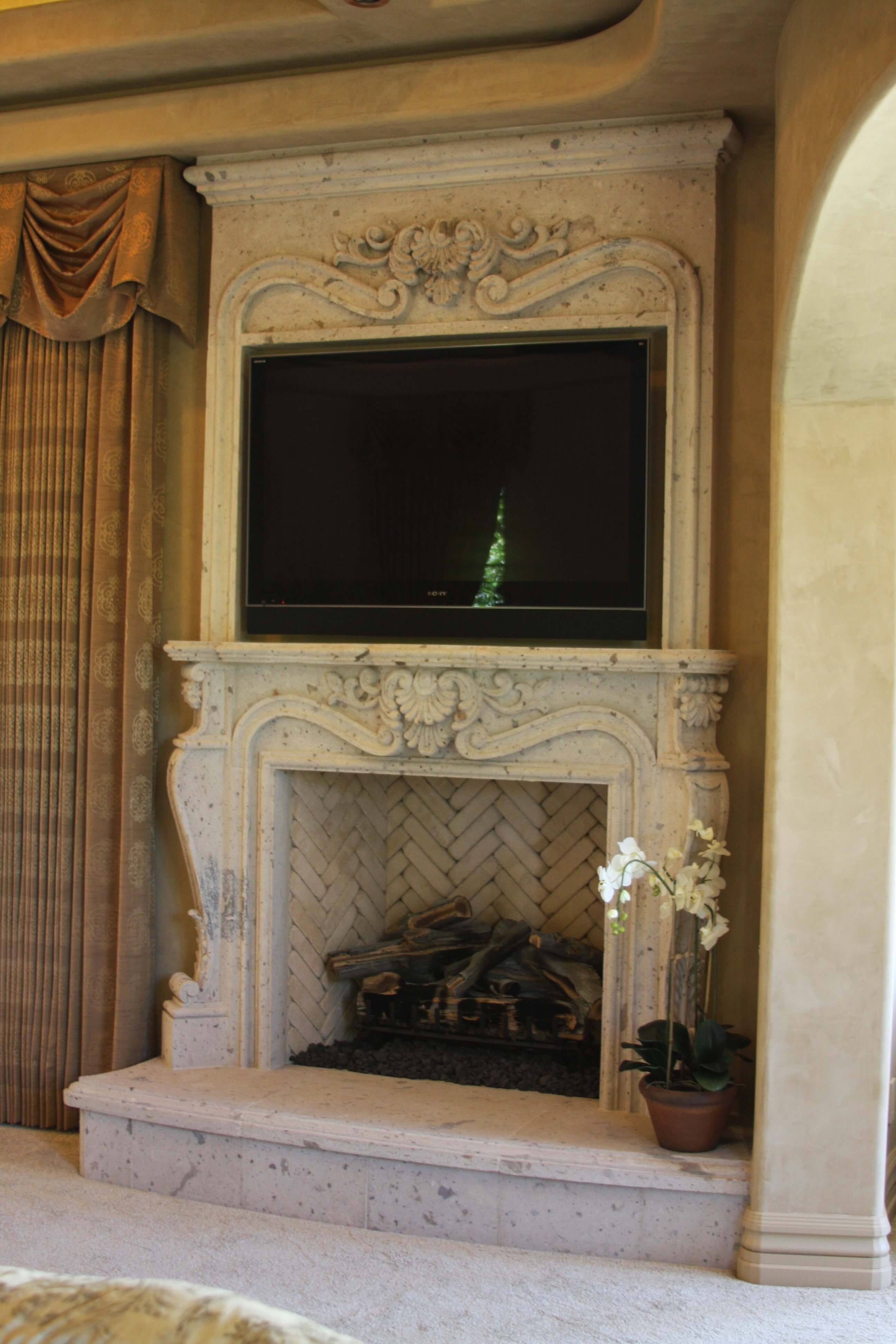 13-Old-World-Fireplace-Surround-at-Master-Bedroom-Suite-in-Rio-Blanco-Cantera-Stone