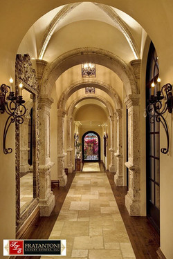 2A-Old-World-Raised-Panel-Columns-at-Hallway-with-Groin-Vault-Mouldings-in-Oro-Cantera-Stone