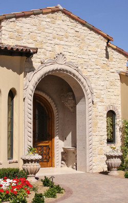 1-Traditional-Tuscan-Single-Rope-Entryway-Door-Surround-with-Thin-Veneer-Stone-around-Opening-in-Pin