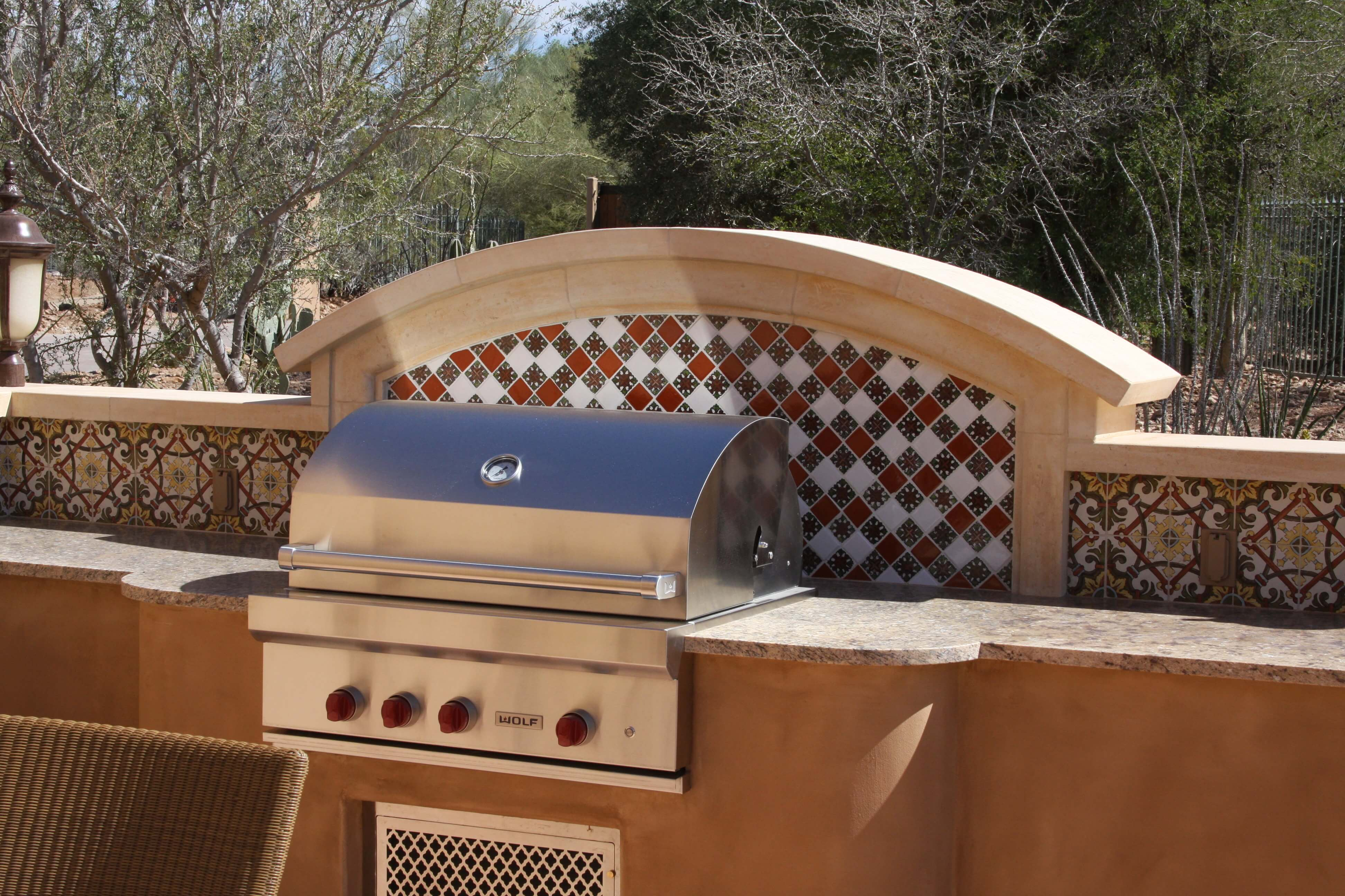 5-Curved-Limestone-Wall-Cap-with-Arched-Moulding-Surround-at-Barbecue-with-Deco-Tile-Backsplash