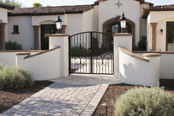 3-Curved-Radius-Wall-Cap-at-Entry-with-Square-and-Round-Pier-Caps-Columns-and-Entry-Door-Surround-in