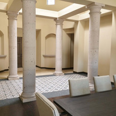 Tuscan Round Stone Columns With Smooth Shafts at Interior