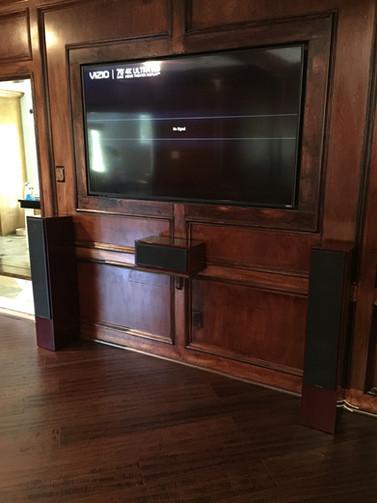 tv inlayed in custom wood paneled walls
