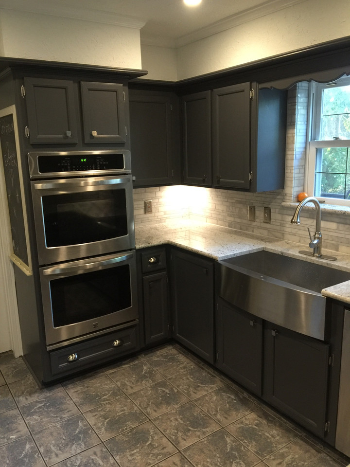 stainless steel appliances with wood cabinets