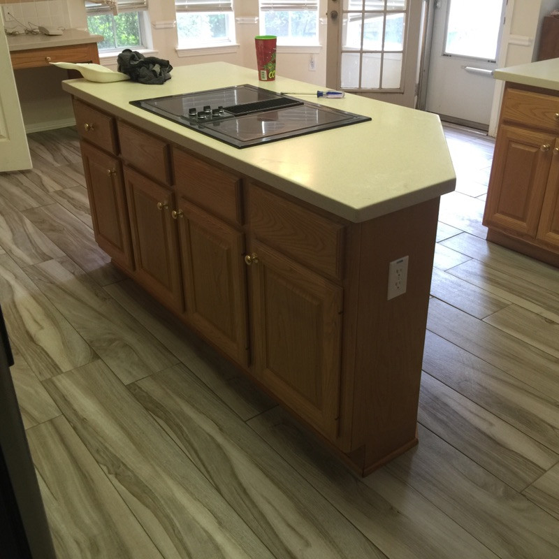 floating kitchen countertop with wood-panel floors