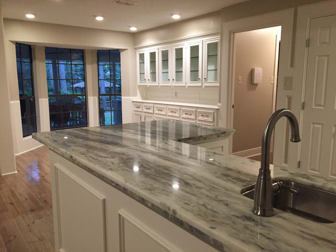 marble kitchen countertop with white cabinets in the background
