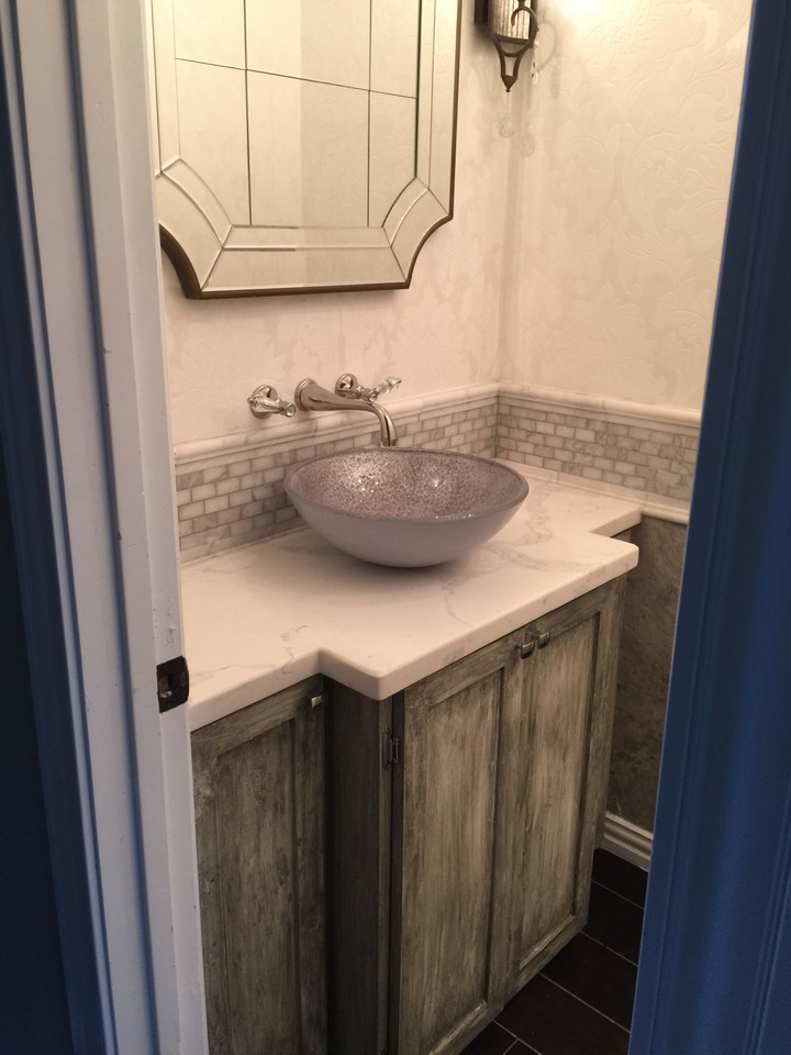 custom wood cabinetry in the bathroom with fancy washing station