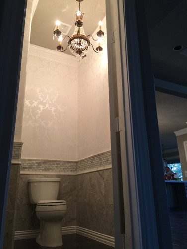 guest bathroom with chandelier