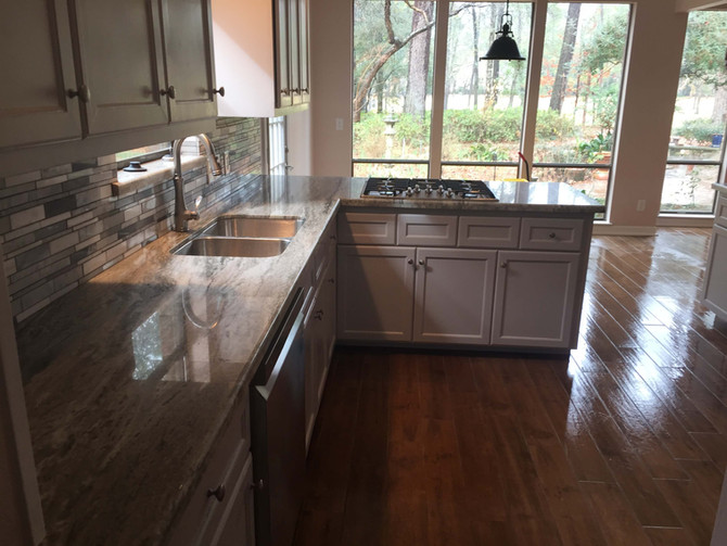 renovated kitchen with marble counter tops