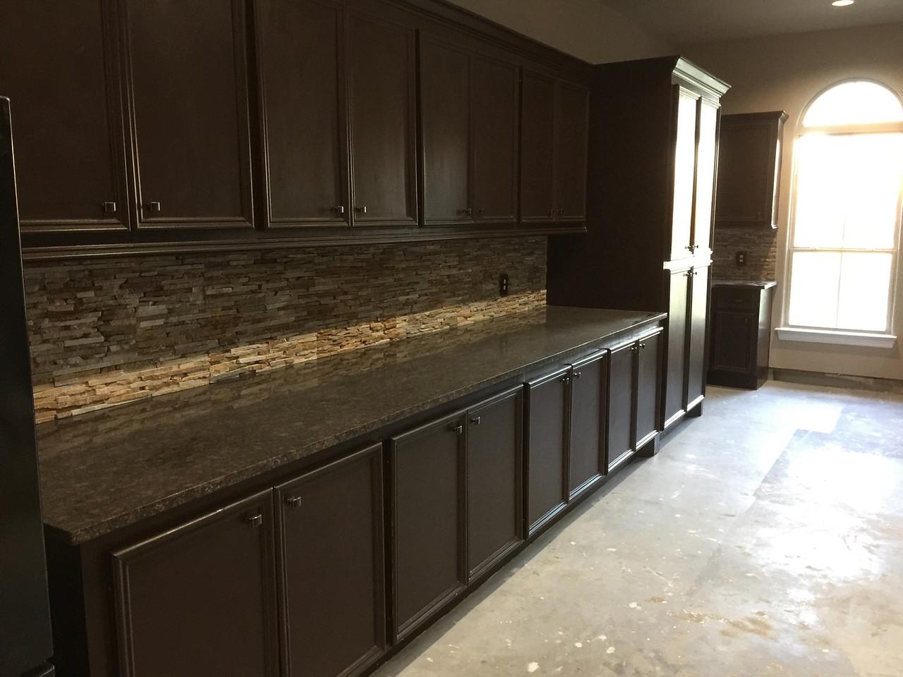 granite countertop with custom wood cabinetry