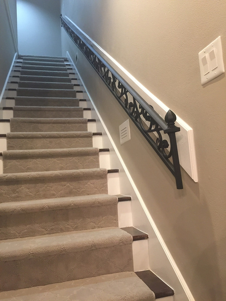 Wood stairs with carpet over them