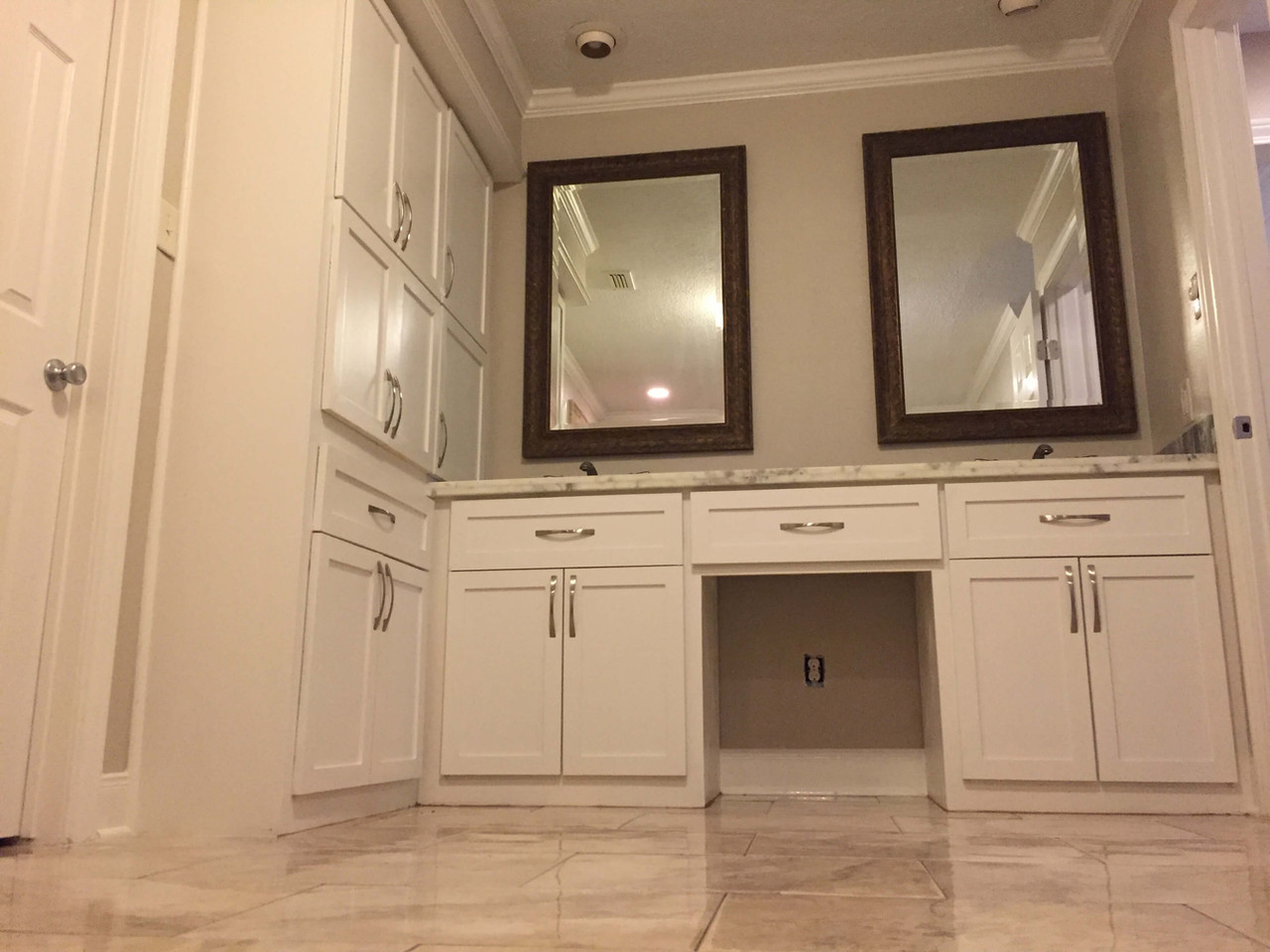all white bathroom with custom white cabinets