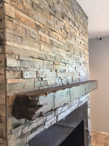 custom brick fireplace with real wood mantle