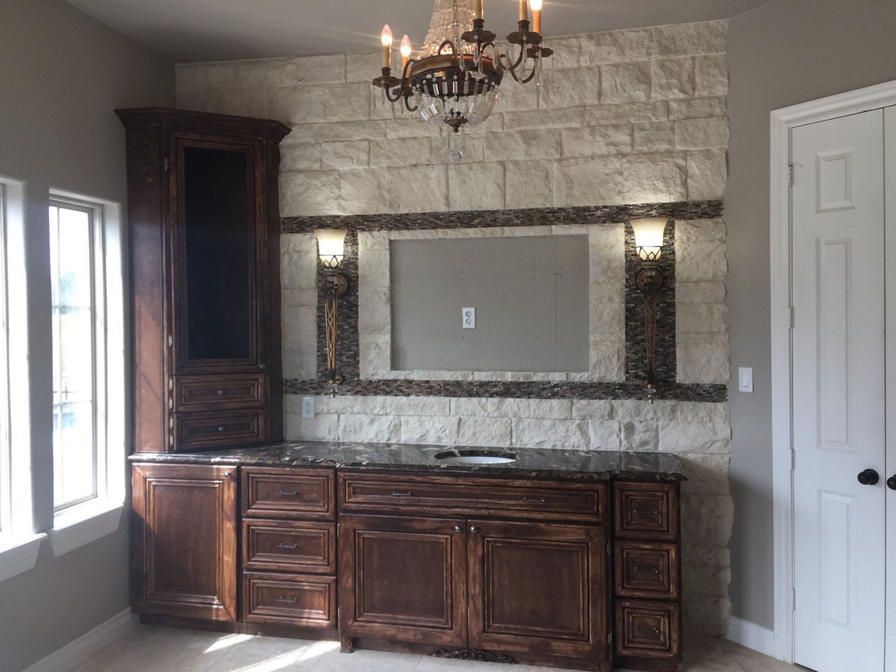 hand built wood cabinetry with brick wall and tv hook up
