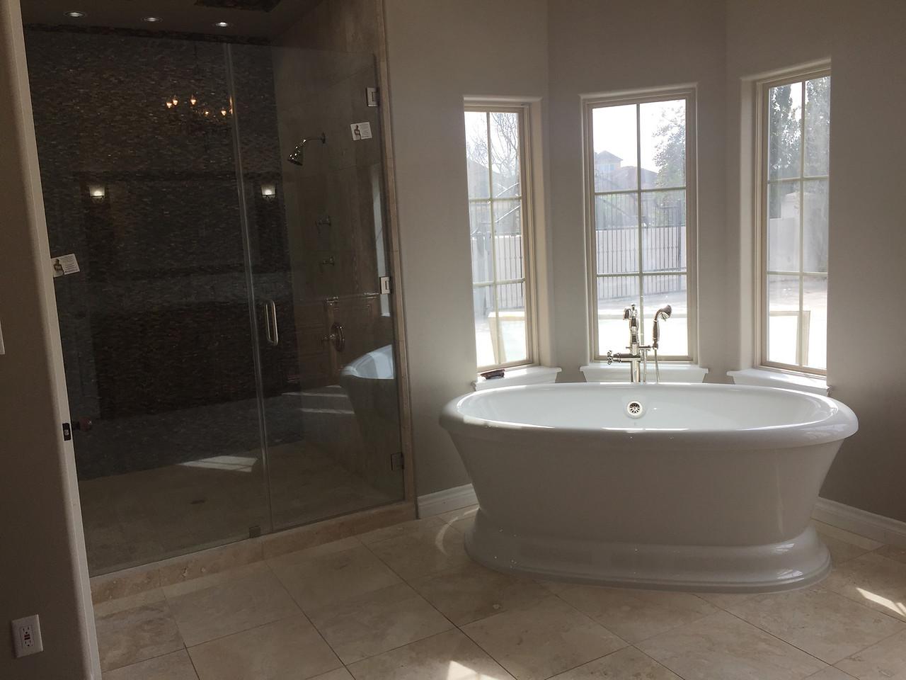 bathroom bathroom with oversized above ground bath tub