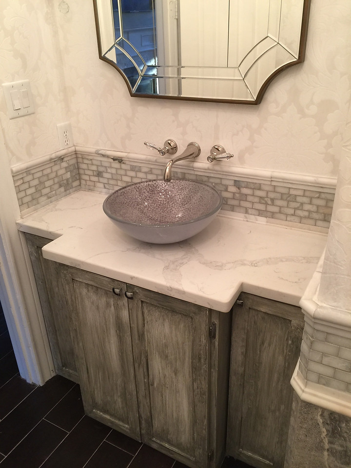 custom bathroom cabinetry with fancy handwashing bowl