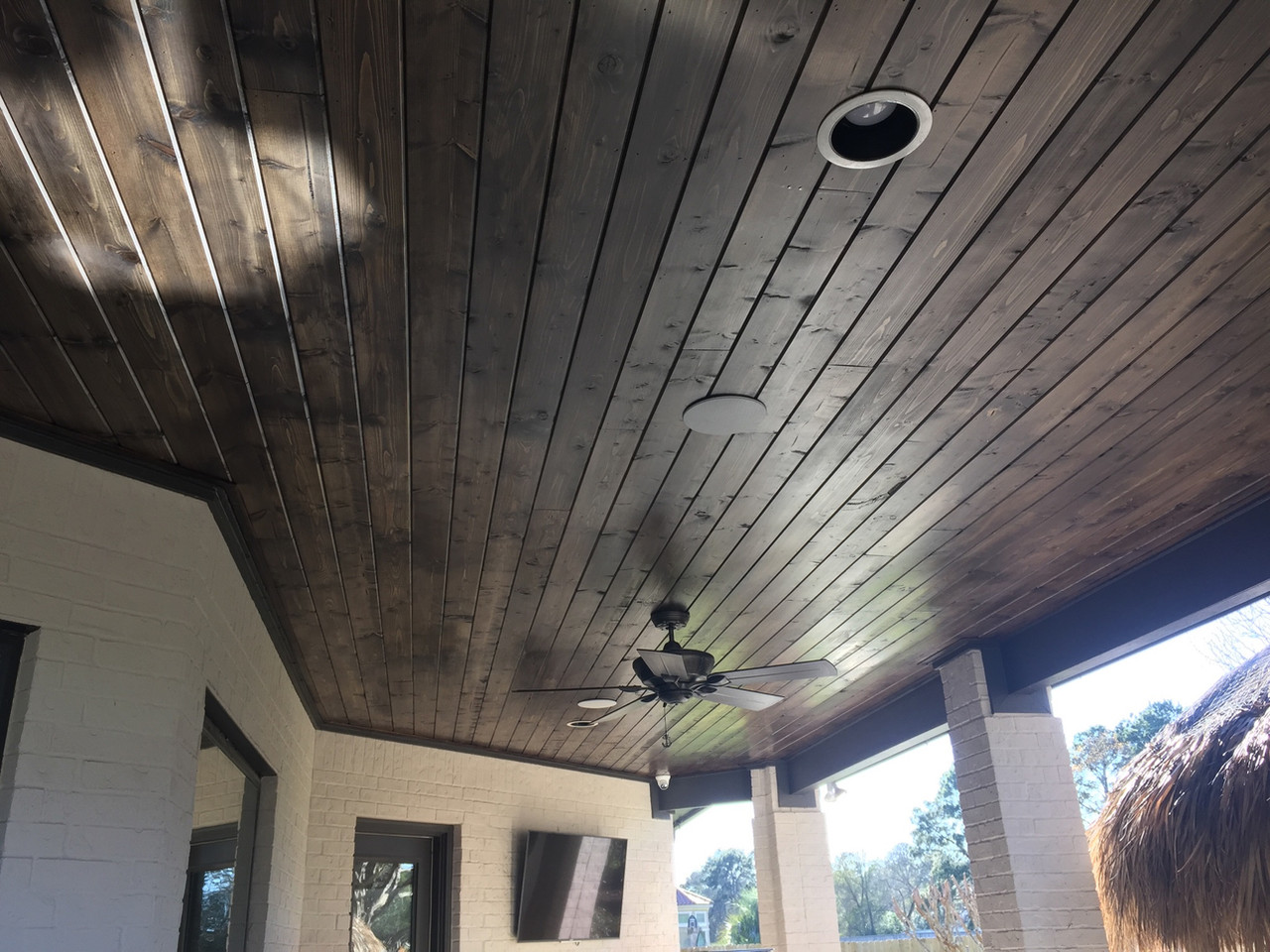 wood paneled outdoor ceiling with surround sound installations