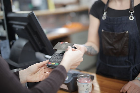 person-holding-credit-card-3907161.jpg