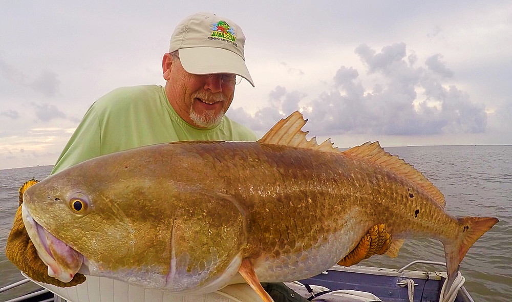 This Gal is why I return year after year for MONSTER BULL RED FISHING!