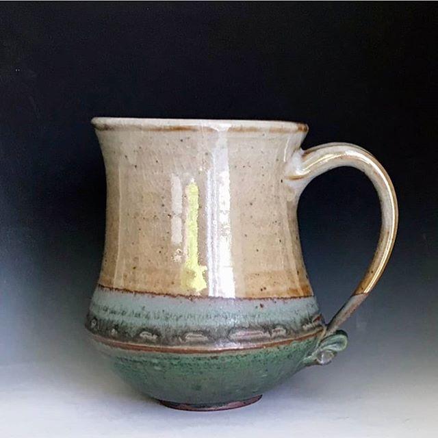 A stoneware mug with a beautiful shino g