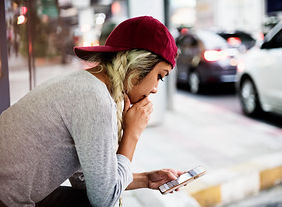 serious-woman-using-smartphone-in-the-mi