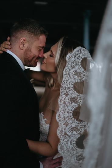 Bride & groom almost kissing