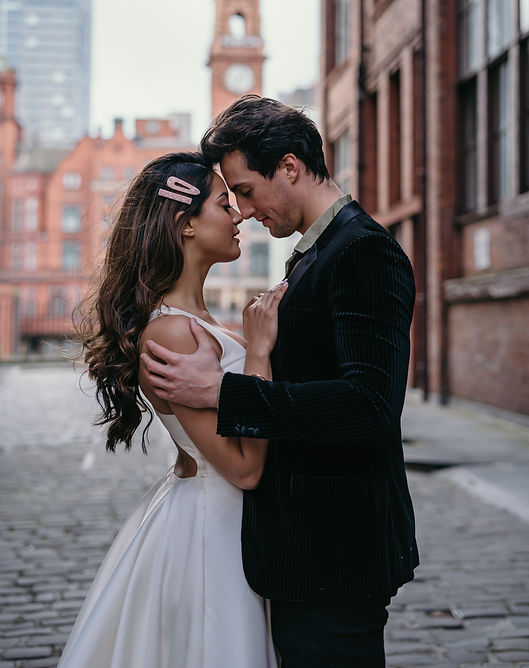 Bride & groom embracing in Manchester Civic Quarter