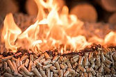 burning-wooden-pellets-front-pile-wood_c