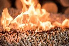 burning-wooden-pellets-front-pile-wood_c